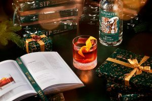 sip book negroni christmas landscape